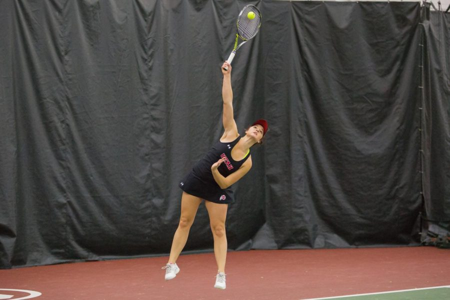 University of Utah junior Brianna Chisholm served the ball as the University of Utah Women's Tennis team take on University of Denver in Salt Lake City, UT on Saturday, February 17, 2018.(Photo by Curtis Lin/ Daily Utah Chronicle)